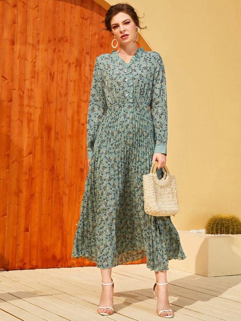 woman in green pleated dress